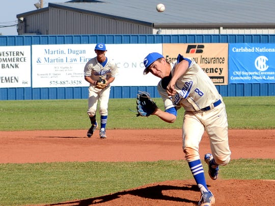 Carlsbad's Nate Arrington fires a pitch starting game