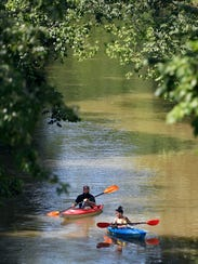 Amanda and Jeff Barnard kayak down the Harpeth River