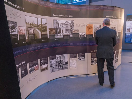 The exhibit includes a timeline of Detroit's history