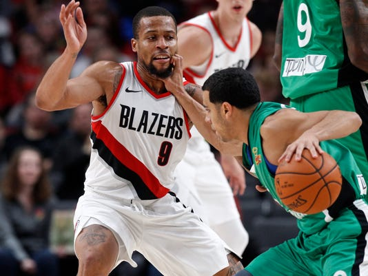 Maccabi Haifa guard Angel Rodriguez, right, gets his hand on the face of Portland Trail Blazers guard Isaiah Briscoe during the second half of an NBA exhibition basketball game in Portland, Ore., Friday, Oct. 13, 2017. (AP Photo/Steve Dipaola)