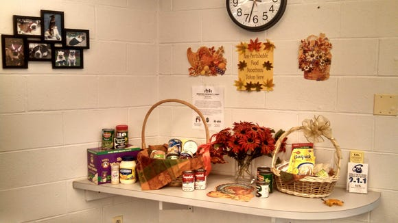 In November, the County Clerk's Office collected six grocery bags full of food for the Webster Community Chest's food cupboard. (Provided photo)