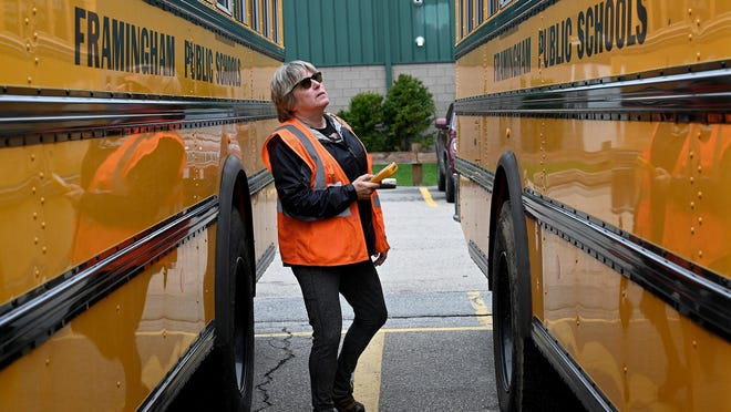 Framingham school officials believe busing contractor Durham School Services has defaulted on its contract and they're demanding the breach be fixed no later than Monday.