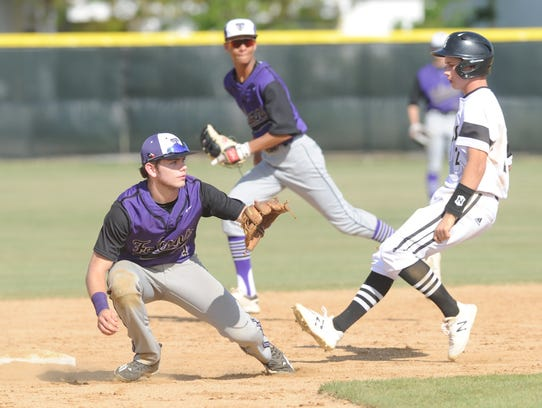 Abilene High's Wes Berry steals second with two outs