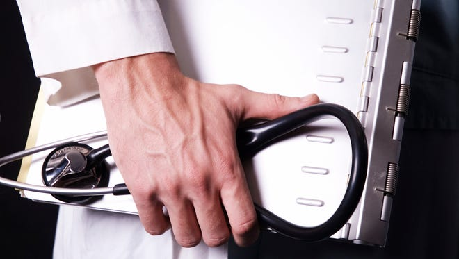 Doctor holding a stethoscope.