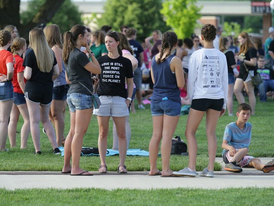 Members of the community arrive for a prayer vigil at Federal Hill Commons in Noblesville in response to a shooting at Noblesville West Middle School.