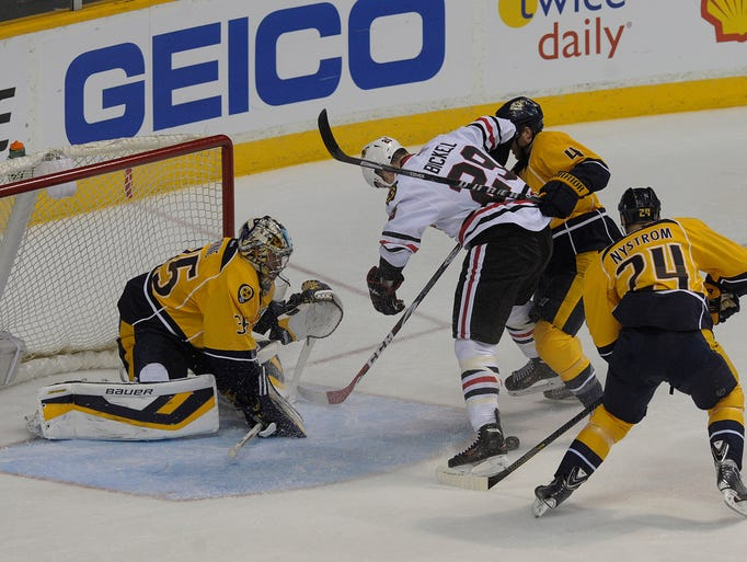 Chicago's Brian Bickell tries to score past Pekka Rinne during Saturday's game at Bridgestone Arena. The Predators won 7-5.