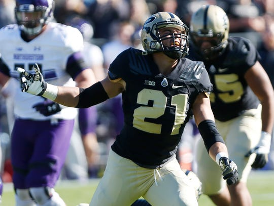 Markus Bailey reacts after the Boilermakers stopped Northwestern on a third and one in the first half Saturday, November 12, 2016, at Ross-Ade Stadium. Northwestern defeated Purdue 45-17.
