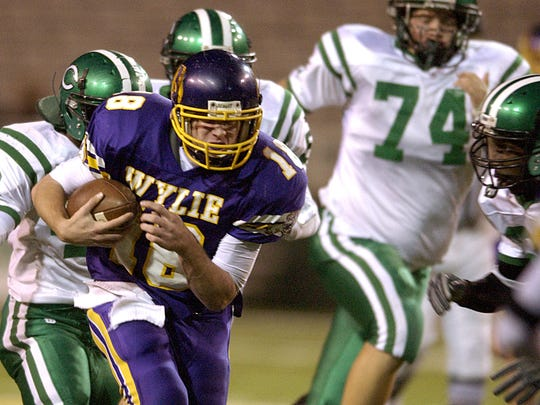 Wylie quarterback Case Keenum (18) runs through Cuero defenders during the Bulldogs' win in the Class 3A Div. I state championship game in December 2004 at Floyd Casey Stadium in Waco.
