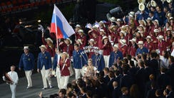 The Russian team, with flag bearer Maria Sharapova,