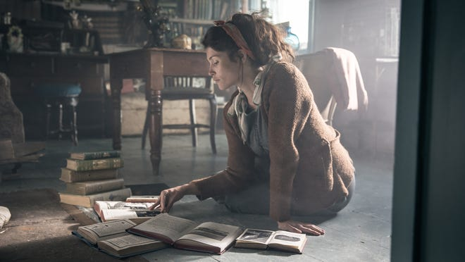 "Alice (Gemma Arterton) attempts to do some research done in ""Summerland."""