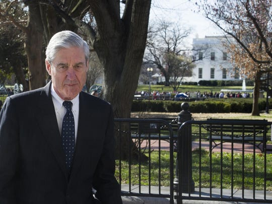 In this March 24, 2019 photo, Special Counsel Robert Mueller walks past the White House, after attending St. John's Episcopal Church for morning services, in Washington.