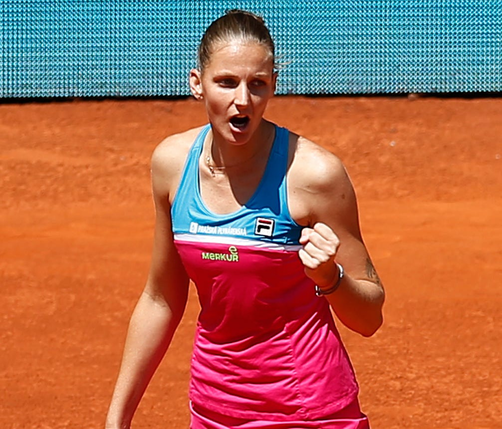 Karolina Pliskova of the Czech Republic celebrates winning a point against Simona Halep of Romania during the Madrid Open Tennis tournament in Madrid, Spain, Thursday, May 10, 2018. Top ranked Halep lost to Pliskova 6-4, 6-3. (AP Photo/Paul White) OR