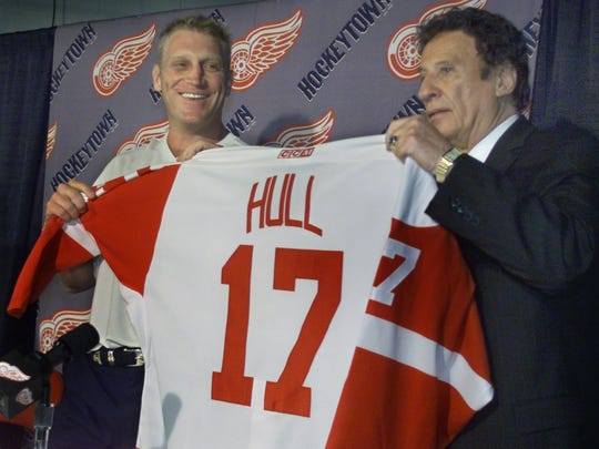 Mike Ilitch handed newcomer Brett Hull his Detroit Red Wings sweater in 2001. It turned out to be one of the best free agency signings the Wings have made the last 20 years.