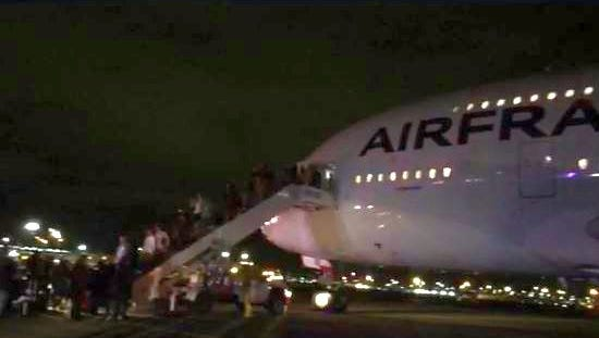 Passengers exit Air France flight 65, from Los Angeles to Paris, after an emergency landing in Salt Lake City, Nov. 17, 2015.