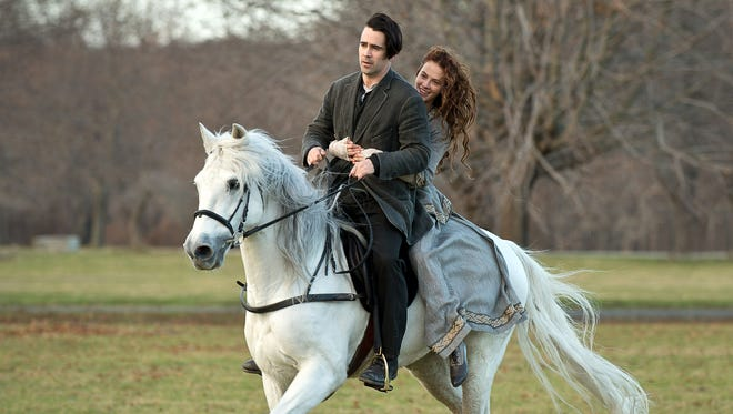 Colin Farrell, left, and Jessica Brown Findlay star in the  time-traveling love story 'Winter's Tale.'