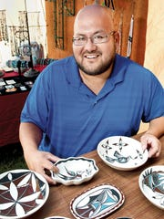 Albert Alvidrez shows some of his creations at the