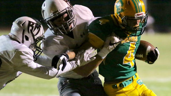 Coachella Valley's Angelo Fitzgerald moves the football to the 4-yard line in the first quarter Friday night against Rancho Mirage.