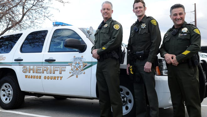Deputies George Wade, 51, Mike Field, 34, and Carlos Bonilla, 54, stand outside Monday at the Washoe County Sheriff's Office. All three are volunteers in the Deputy Reserve Program.