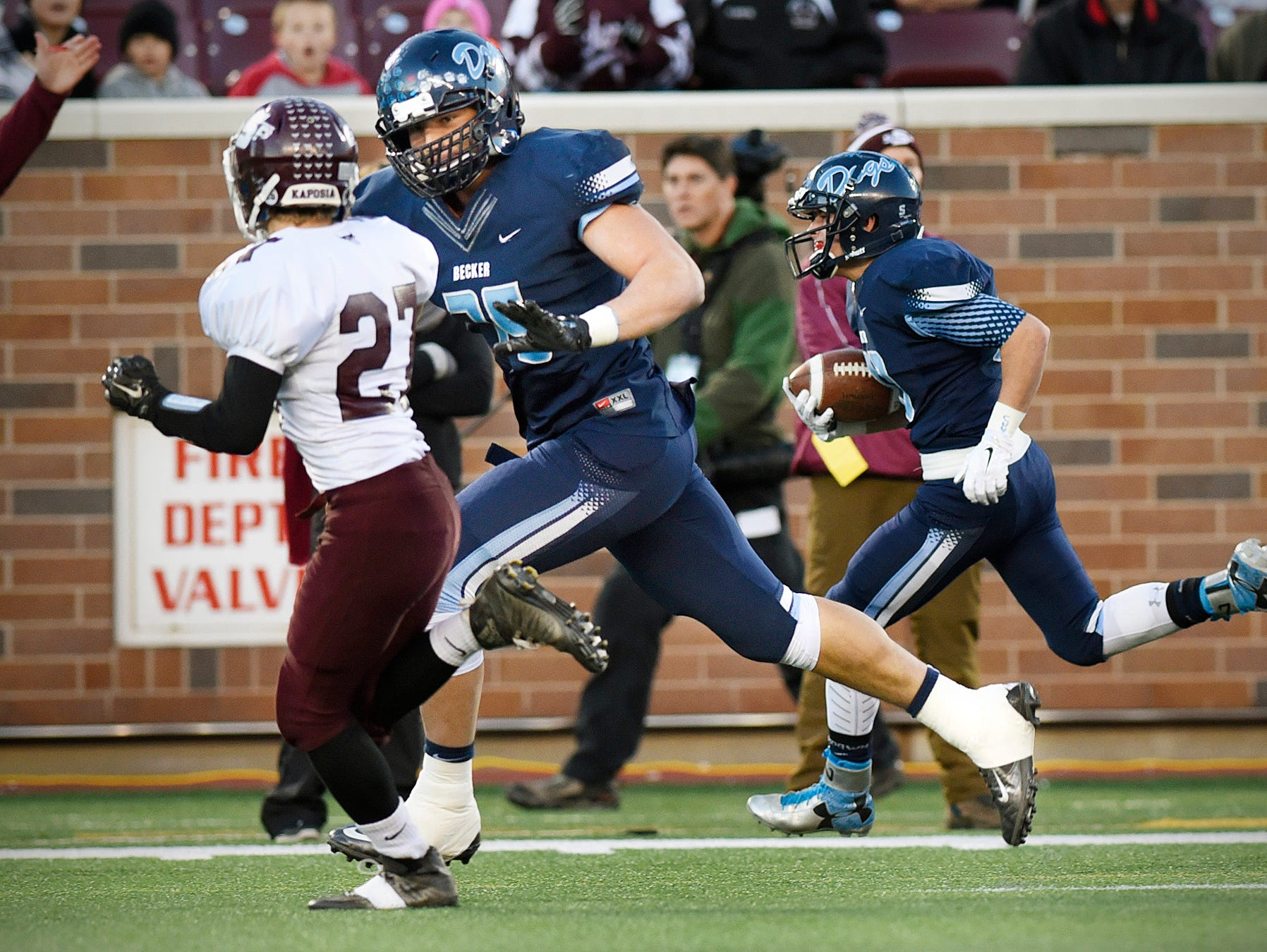 Becker's Dillon Radunz (center) make the key block to send tailback Gabe Dertinger in to score against South St. Paul in the first half of the Nov. 13 Class 4A state title game at TCF Bank Stadium in Minneapolis.