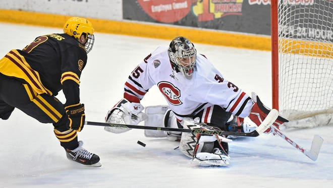 St. Cloud State goaltender Charlie Lindgren blocks a shot by Arizona State's Edward McGovern during Saturday's game at the Herb Brooks National Hockey Center in St. Cloud.