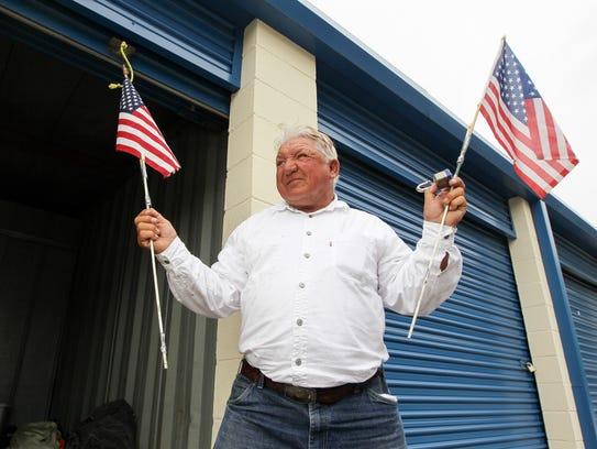 Jessie Alexander, seen in 2012 holding his American