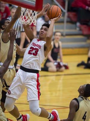 Center Grove High School junior Trayce Jackson-Davis (23) puts up a shot during the second half of an IHSAA boys' varsity basketball game Thursday, February 1, 2018, at Center Grove High School. Warren Central (18-0) won, 50-42.