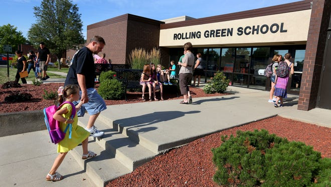 Hadley Kinning, 5, of Urbandale, and her father, Kyle Kinning, arrive on the first day of school at Rolling Green Elementary School in Urbandale on Thursday, July 24, 2014. This was Hadley's first day of kindergarten.