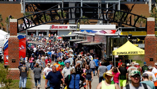Fans walk to the track before the 2014 Bojangles' Southern 500 at Darlington Raceway on April 12.