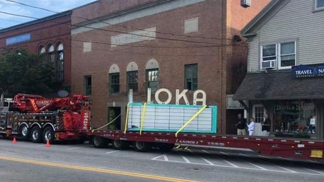 A crew hired by the new owners of the former theater, David Cowie and Jay Caswell of Ioka Properties LLC, removed the iconic marque early Friday morning.