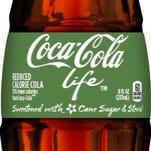 An 8 oz. glass bottle of Coca-Cola Life. Coca-Cola Life is sweetened with a blend of sugar and stevia leaf extract.