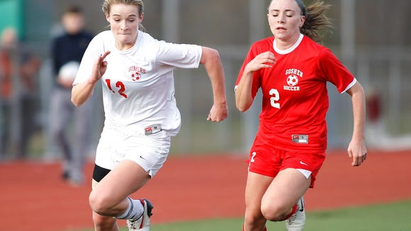 Somers' Hannon Eberts (12) works the ball through the Goshen defense during their 1-0 win in the girls Class A regional final at Arlington High School in Arlington Nov. 9, 2014.