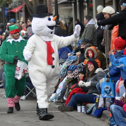 Frosty the Snowman greets the crowd during a recent Christmas Parade in downtown Milford.