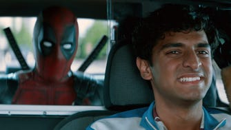 "This image released by Twentieth Century Fox shows Ryan Reynolds and Karan Soni in a scene from ""Deadpool 2."""
