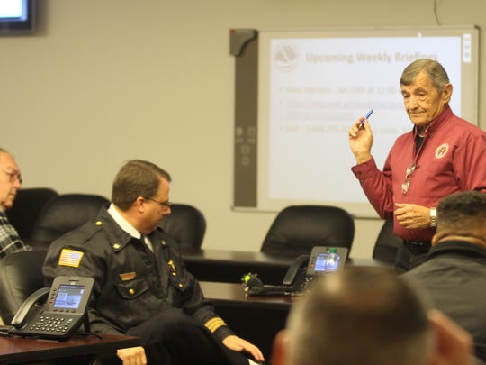 Emergency Management Director Jerry Buchanan and representatives from city, county, state and federal agencies meet Tuesday morning for a briefing about snow that could impact the Clarksville area Wednesday morning.