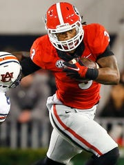 Georgia running back Todd Gurley tries to get past