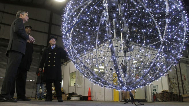 "White Plains Mayor Thomas Roach, left, Recreation and Parks Commissioner Wayne Bass and DPW Commissioner Joseph ""Bud"" Nicoletti on Dec. 30, 2014 look over the ball that will be dropped during the annual White Plains New Year's Eve celebration."