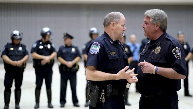 Knoxville's Chief of Police, David Rausch, left, speaks with Knox County Sheriff Jimmy Jones during the Knoxville-Knox County Peace Officers Memorial Service at the Civic Coliseum in Knoxville, on Thursday, May 18, 2017.  (Shawn Millsaps/Special to News Sentinel)