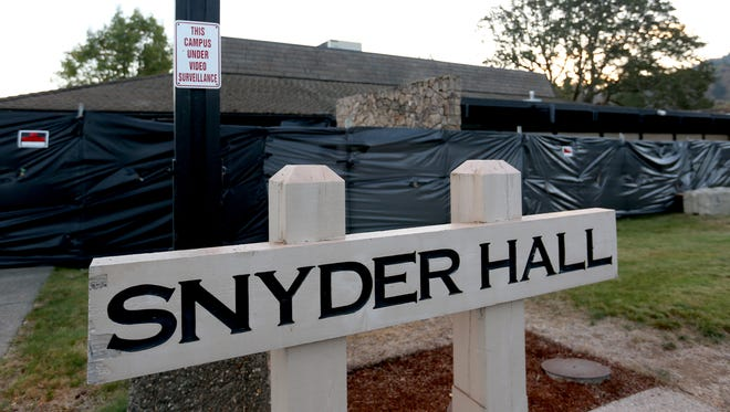 Snyder Hall is closed and surrounded by black plastic at Umpqua Community College in Roseburg, Ore., on Friday, Oct. 9, 2015. Ten people, including the gunman, were killed and nine others injured in a mass shooting at UCC on Oct. 1.