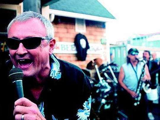 then-Ocean City Mayor Jim Mathias sings Rolling Stones with Mary Lou and the Untouchables at MR Ducks on Talbot Street during a Labor Day celebration in 2004. Mathias was a good friend of the band's lead singer, Mary Lou Magee-Kern, who died Thursday.