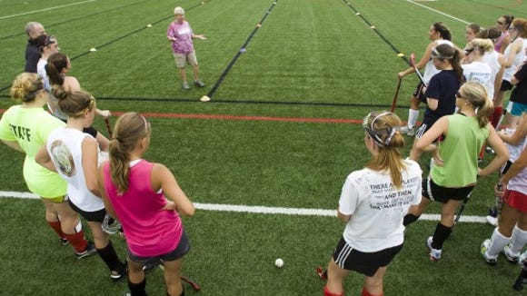 Susquehannock field hockey coach Sharon McLaughlin talks to her team on the first day of practice in 2011. Fall sports practices for the 2013 campaigns begin today.