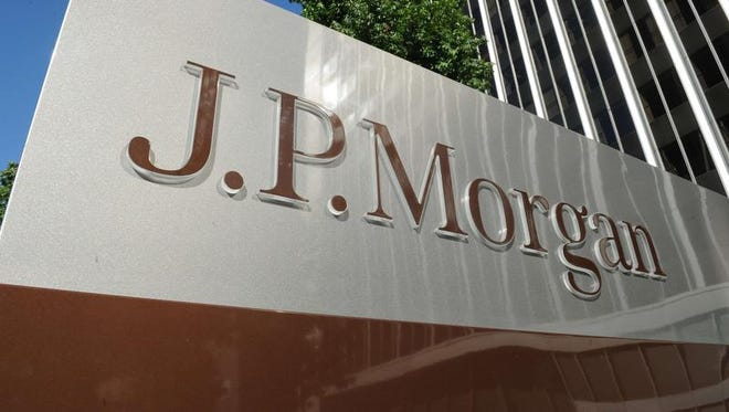 JPMorgan Chase is raising the base pay for all of its employees to at least $12 an hour.