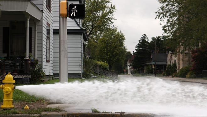 Indiana American Water Co. flushes a fire hydrant in Muncie.
