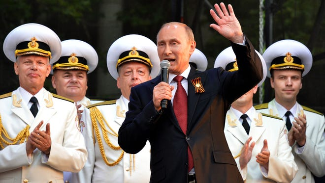 Russian President Vladimir Putin speaks during his visit to the Crimean port of Sevastopol.