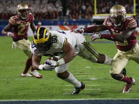 Michigan fullback Khalid Hill dives for a touchdown