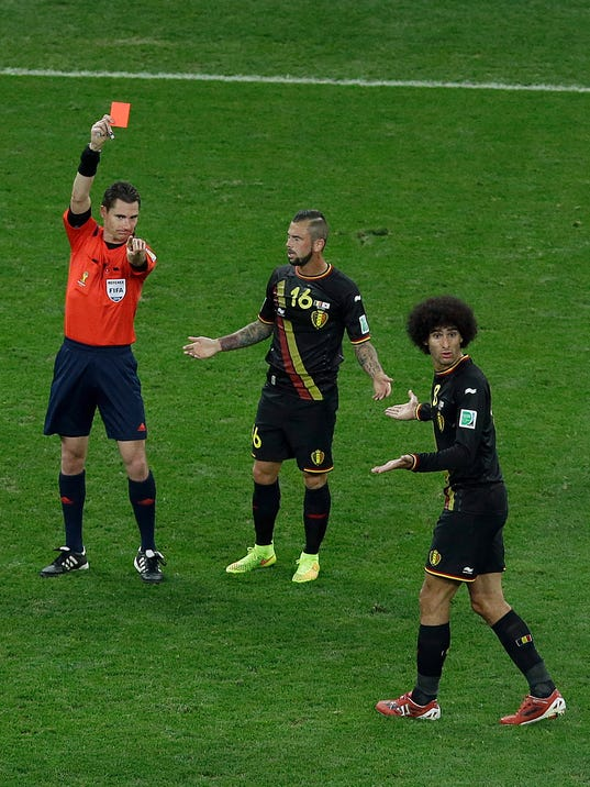 Belgium's Steven Defour (16) is given a red card after fouling South Korea's Kim Shin-wook (not seen), as team mate Marouane Fellaini tries to argue during the group H World Cup soccer match between South Korea and Belgium at the Itaquerao Stadium in Sao Paulo, Brazil, Thursday, June 26, 2014. (AP Photo/Andrew Medichini)