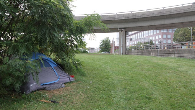 Some homeless people still have tents near their former encampment in Rochester.