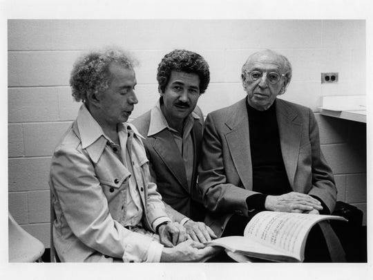 "(Right to left): Composer Aaron Copland, MOT founder David DiChiera and choreographer Eugene Loring discuss Copland's ""The Tender Land"" in 1978."