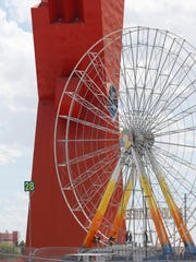 """The Global Wheel, the biggest Ferris wheel in Latin America at 150 feet high, will be one of many attractions for visitors to the 2016 Feria Juárez, which will open its doors Friday at the Plaza de la Mexicanidad, where """"The X"""" monument stands, and run through Oct. 9. Another attraction will be the Mega King Tower, a free-fall 265-foot tower with a 25-foot King Kong figure on top. More than 40 rides will be available to fairgoers."""