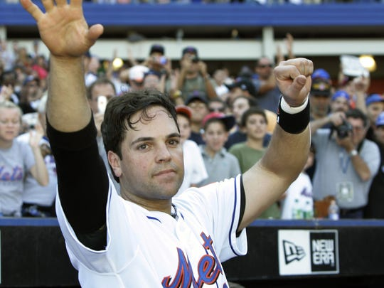 In this Oct. 2, 2005, file photo, New York Mets catcher Mike Piazza acknowledges fans' applause following a tribute to Piazza's seven-year career with the Mets during the seventh inning of the team's 11-3 loss to the Colorado Rockies at Shea Stadium in New York. Piazza earned election into the Baseball Hall of Fame on Wednesday.