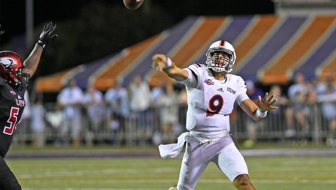 Demons quarterback Brooks Haack throws under pressure in last week's 21-18 loss to Incarnate Word.
